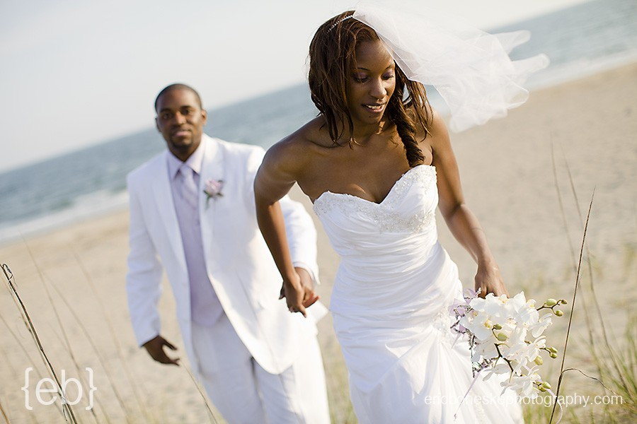 bride and groom walk on beach at bald head island