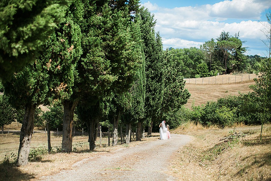 eric boneske photography, wedding photographer, destination, Tuscany Italy, marriage, wedding, love, groom, groomsmen, friends, family, venue, destination wedding, ceremony, reception, daughter, flower girl, outside, field, dirt road,
