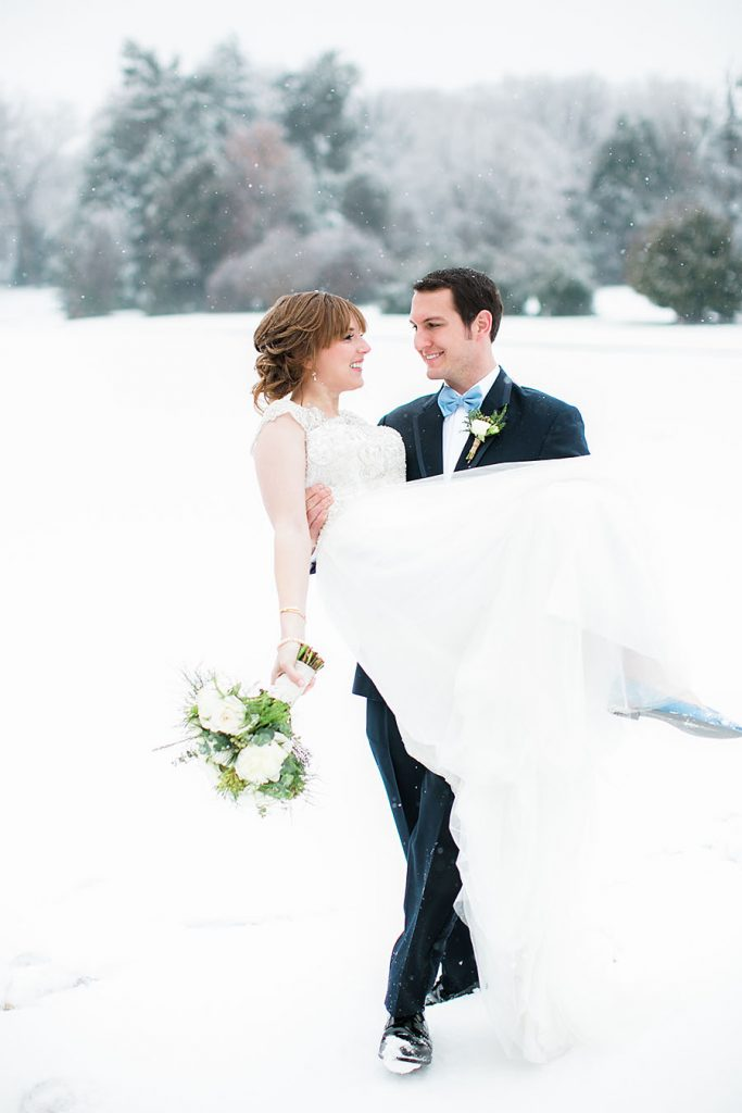 eric boneske photography, sedgefield Country Club, wedding, bride, groom, snow, bouquet, flowers, boutonniere, white wedding dress, winter wedding,